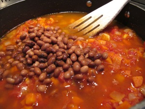 adding beans to the pan 3-12-13