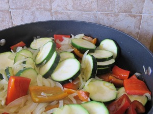 in the pan, add courgettes