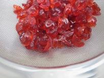 cherries, in sieve