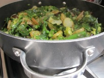 in the pan - add peas and herbs